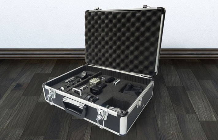 An image of a hard case open displaying the foam padding on the inside depicting how Rubberlite provides for Packaging