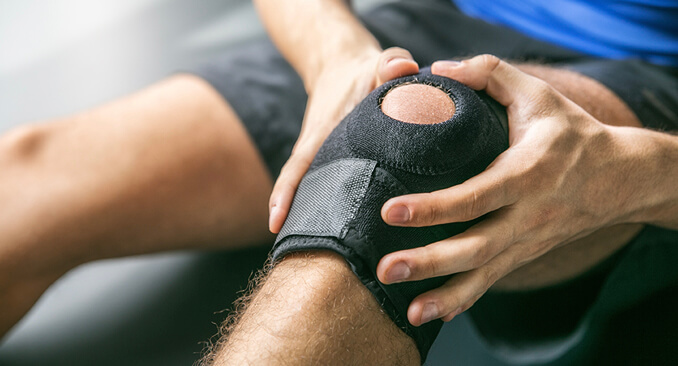 AN image of a person handling a knee brace depicting how Rubberlite provides services in Medial areas